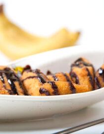 Banane prăjite – Desert - Restaurantul cu specific chinezesc, KungFu King, cu livrare la domiciliu vă oferă cea mai bună mâncare chinezească din Bucureşti, fapt confirmat de clienţii noştri. Acum puteţi face comanda online şi vă puteţi, astfel, bucura de ofertele speciale oferite de restaurantul chinezesc KungFu King din Bucureşti. Vă invităm să încercaţi un desert absolut delicios marca KungFu-King.